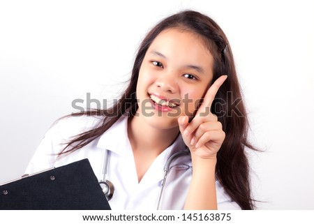 Smiling young woman doctor holding black cardboard - stock photo