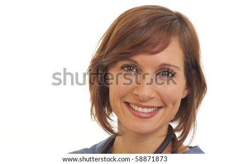 Smiling young woman doctor in scrubs - stock photo