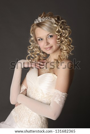 Smiling young woman dressed as a bride.