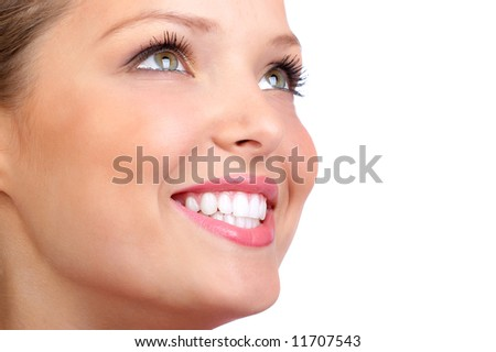 Smiling  young woman face with perfect  teeth. - stock photo
