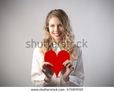 Smiling young woman holding a hearth
