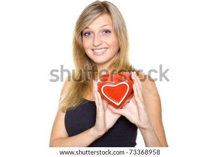 Smiling Young Woman Holding a red Heart. Lots of copyspace and room for text on this isolate