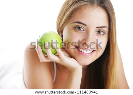 Smiling Young Woman Holding Apple, close up - stock photo