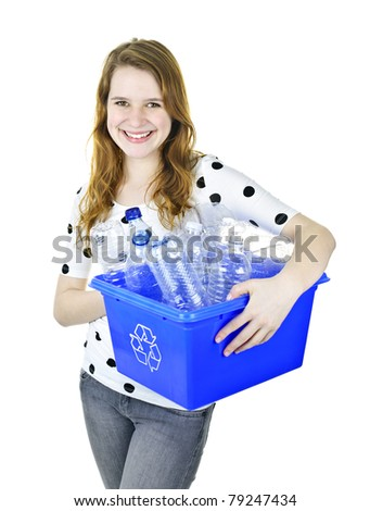 Smiling young woman holding full recycling box isolated on white - stock photo