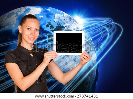 Smiling young woman holging tablet looking at camera on earth model background. Connection all over the world. Elements of this image furnished by NASA