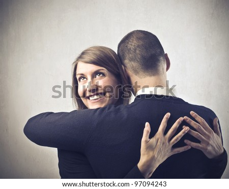 Smiling young woman hugging her husband