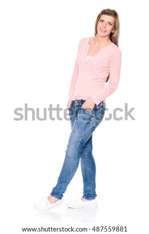 Smiling young woman in front of white background