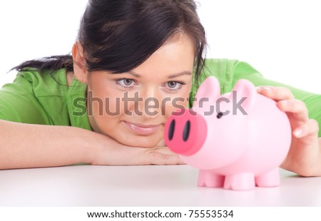 smiling young woman in green blouse with pink piggy bank - stock photo