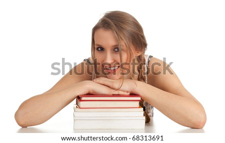 smiling young woman in pigtail with stack of books