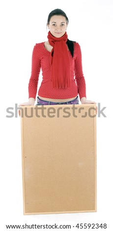 Smiling young woman in red blouse keeping cork board - stock photo