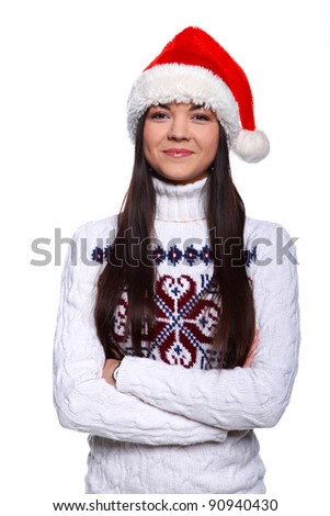 Smiling young woman in red christmass hat at white background - stock photo