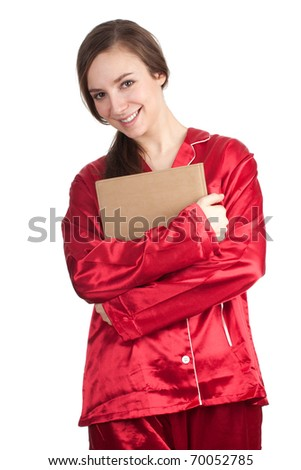 smiling young woman in red pajamas with brown book