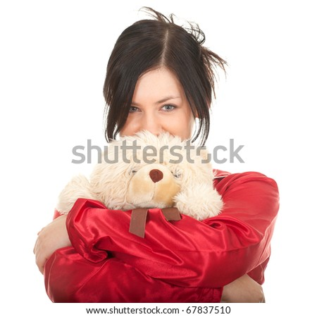 smiling young woman in red pajamas with teddy bear - stock photo