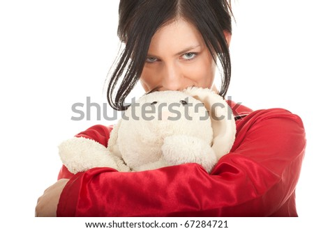 smiling young woman in red pajamas with teddybear - stock photo