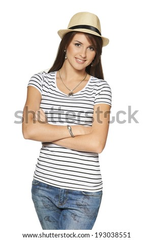 Smiling young woman in stripped tshirt and straw hat with folded hands looking at camera, isolated on white background.