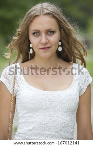 smiling young woman in summer dress outdoor - stock photo