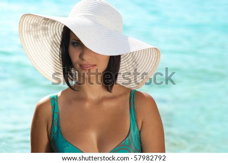 Smiling young woman in the white hat - stock photo