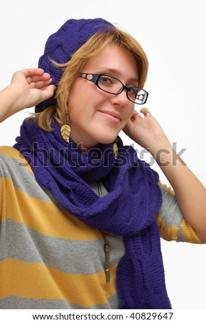 Smiling young woman in violet beret over white - stock photo