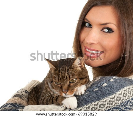 smiling young woman in warm sweater with grey  cat - stock photo