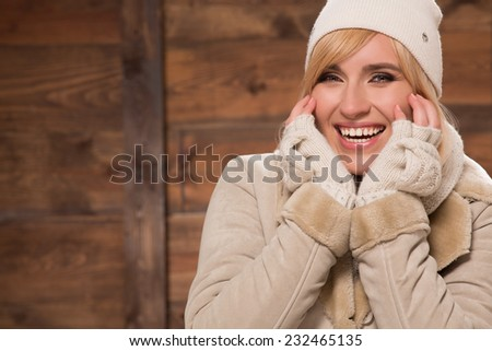 Smiling young woman in wear for cold weather - stock photo