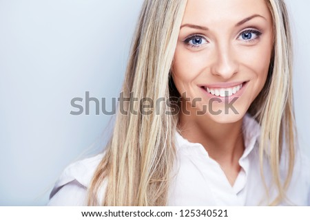 Smiling young woman in white shirt - stock photo
