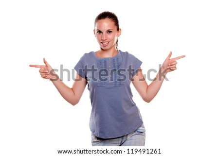 Smiling young woman looking at you and pointing to her left and right on blue shirt on isolated background - copyspace - stock photo