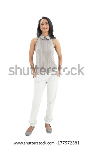 Smiling young woman looking up over white background