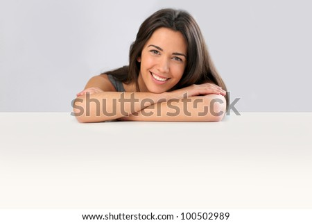 Smiling young woman on white background - stock photo