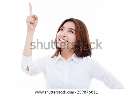 Smiling young woman pointing upwards isolated on white background.  - stock photo