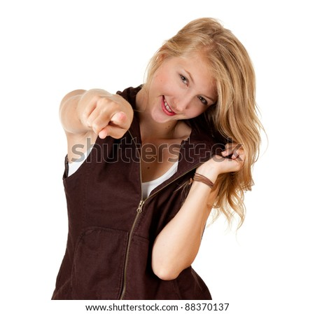smiling young woman pointing you, white background - stock photo