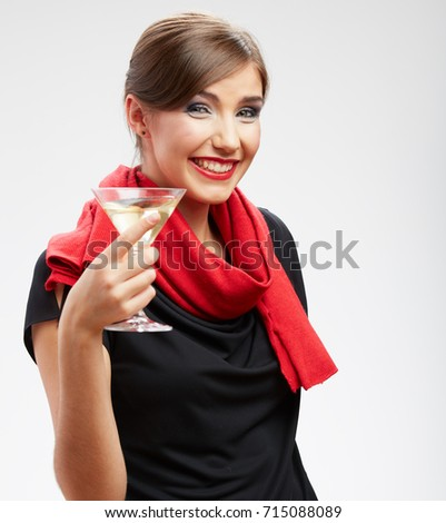 Smiling young woman portrait with cocktail glass dressed black dress and red scarf. isolated portrait.