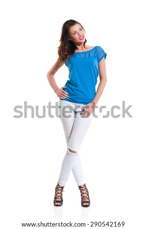 Smiling Young Woman Posing. Full length studio shot Isolated on white.