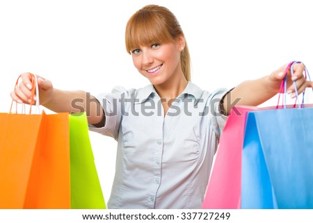 Smiling young woman posing with lots of shopping bags isolated on white background with copyspace
