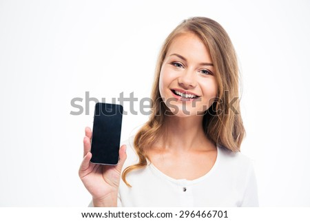 Smiling young woman showing blank smartphone display isolated on a white background. Looking at camera - stock photo