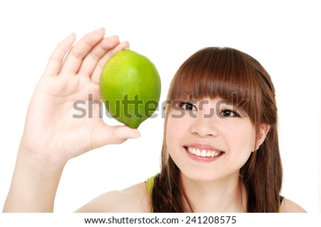 smiling young woman showing limes - stock photo