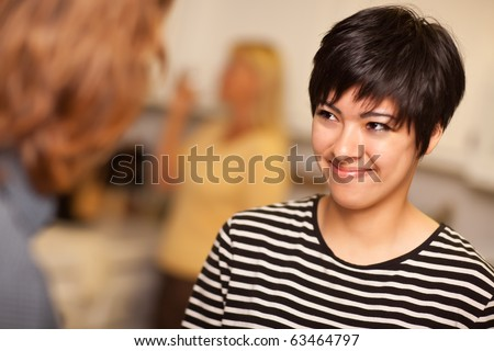 Smiling Young Woman Socializing in a Party Setting. - stock photo