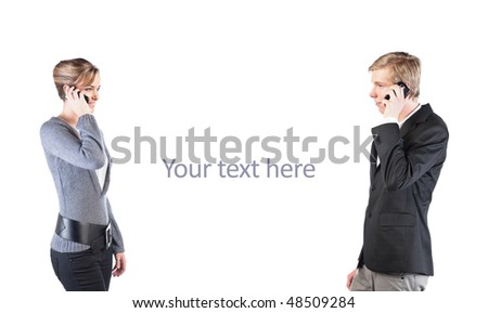 Smiling young woman speaking on cellphone, facing young handsome man with cellphone; isolated on white - stock photo