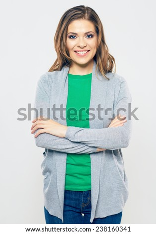Smiling young woman standing against white background. beautiful woman with long hair. - stock photo