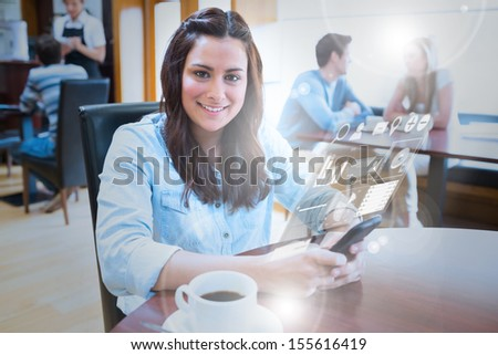Smiling young woman studying on futuristic smartphone in bright cafe - stock photo