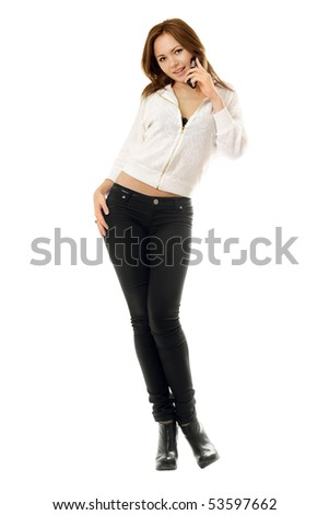 Smiling young woman talking on the phone. Isolated - stock photo
