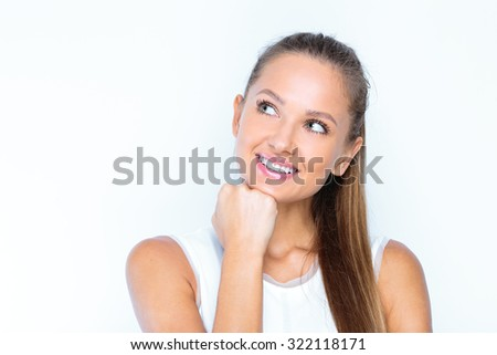smiling young woman with amazing smile , studio portrait. close up of a happy business woman posing to get a perfect studio shot. - stock photo