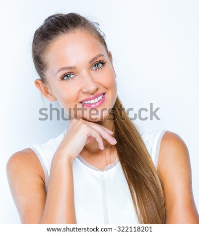 smiling young woman with amazing smile , studio portrait. close up of a happy business woman posing to get a perfect studio shot.