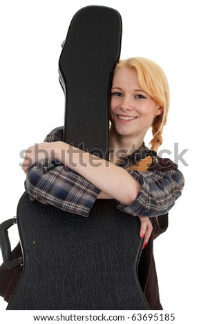 smiling young woman with black case of guitar - stock photo
