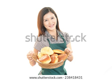 Smiling young woman with breads - stock photo