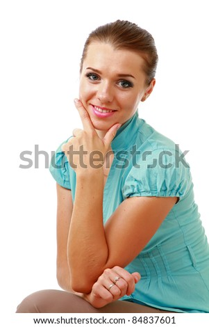 Smiling young woman with chin resting on hand isolated - stock photo