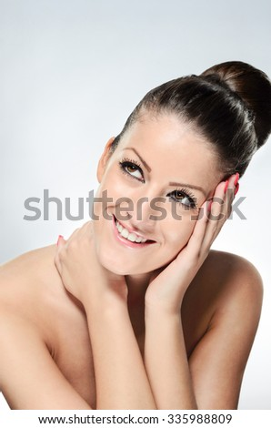 Smiling young woman with clean skin on white background