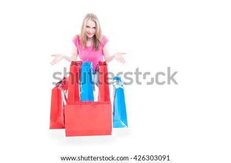 Smiling young woman with colorful shopping bags enjoying sales with copyspace isolated on white background - stock photo