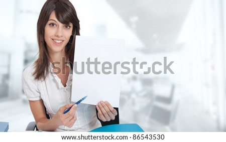 Smiling young woman with customable document in a working environment - stock photo