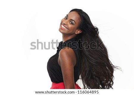 Smiling young woman with flowing hair isolated on white background