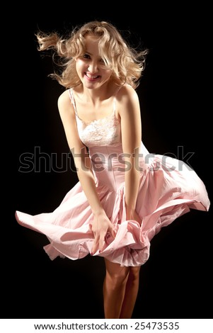 Smiling young woman with fluttering dress